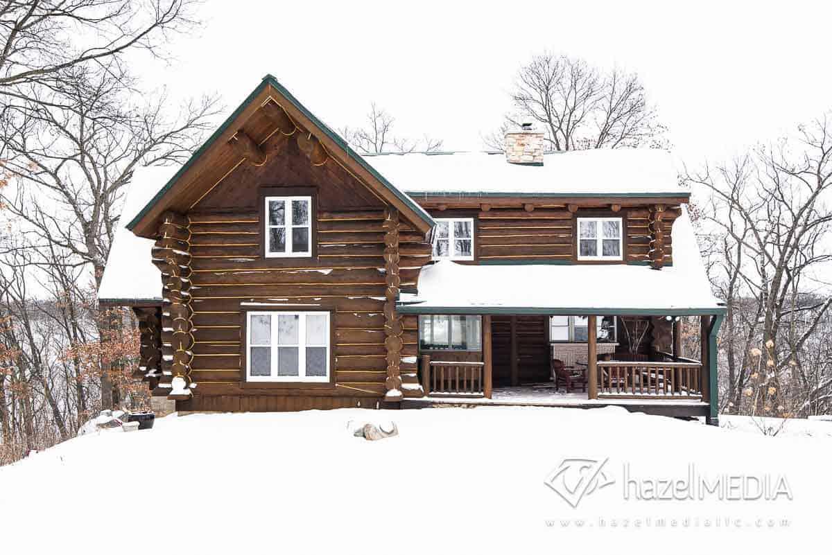 Log residential home exterior winter