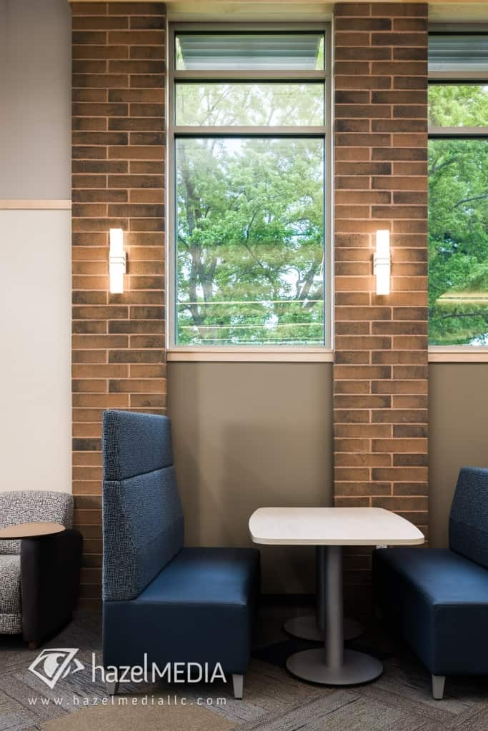 Library Seating with Brick Wall and Scone Lights